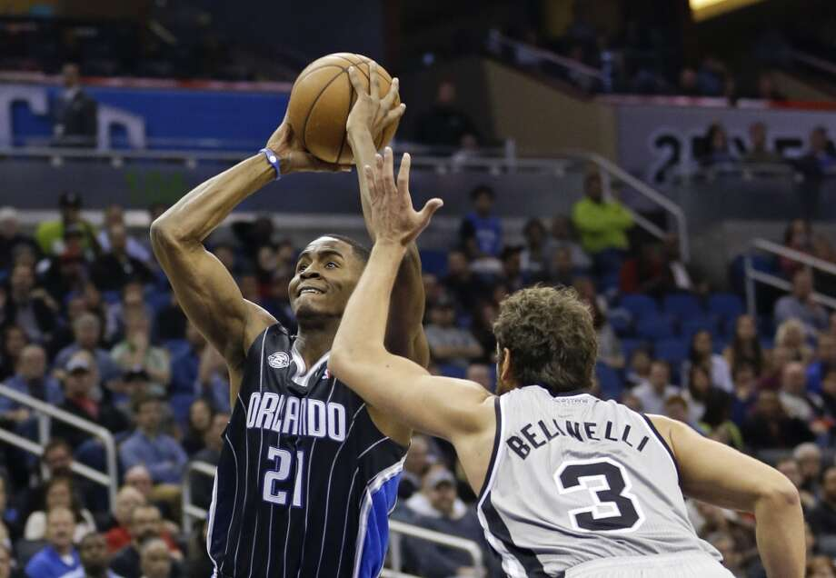 Orlando Magic's Maurice Harkless (21) makes a shot over San Antonio Spurs' Marco Belinelli (3), of Italy, during the first half of an NBA basketball game in Orlando, Fla., Friday, Nov. 29, 2013.(AP Photo/John Raoux) Photo: Associated Press