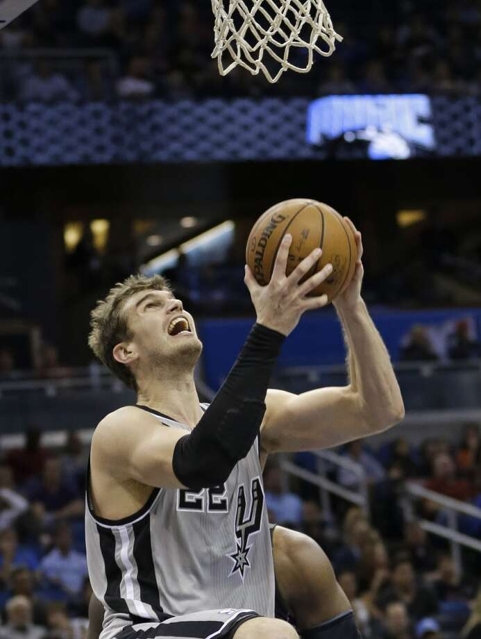 San Antonio Spurs' Tiago Splitter goes up for a shot against the Orlando Magic during the second half of an NBA basketball game in Orlando, Fla., Friday, Nov. 29, 2013. San Antonio Spurs won the game 109-91.(AP Photo/John Raoux) Photo: Associated Press