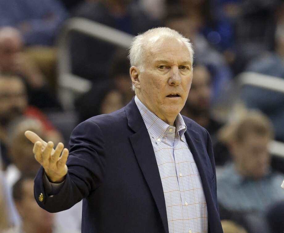 San Antonio Spurs head coach Gregg Popovich directs his team against the Orlando Magic during the first half of an NBA basketball game in Orlando, Fla., Friday, Nov. 29, 2013.(AP Photo/John Raoux) Photo: Associated Press