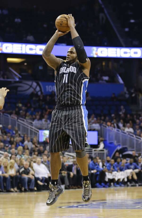 Orlando Magic's Glen Davis (11) takes a shot against the San Antonio Spurs during the first half of an NBA basketball game in Orlando, Fla., Friday, Nov. 29, 2013.(AP Photo/John Raoux) Photo: Associated Press