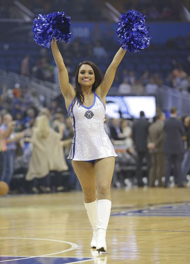 Orlando Magic dancers perform during the first half of an NBA basketball game against the San Antonio Spurs in Orlando, Fla., Friday, Nov. 29, 2013.(AP Photo/John Raoux) Photo: Associated Press