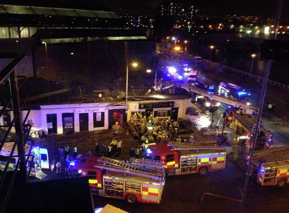 A police helicopter crashed into the roof of a popular pub in Glasgow, Scotland, late Friday night. Photo: Jan Hollands / Associated Press