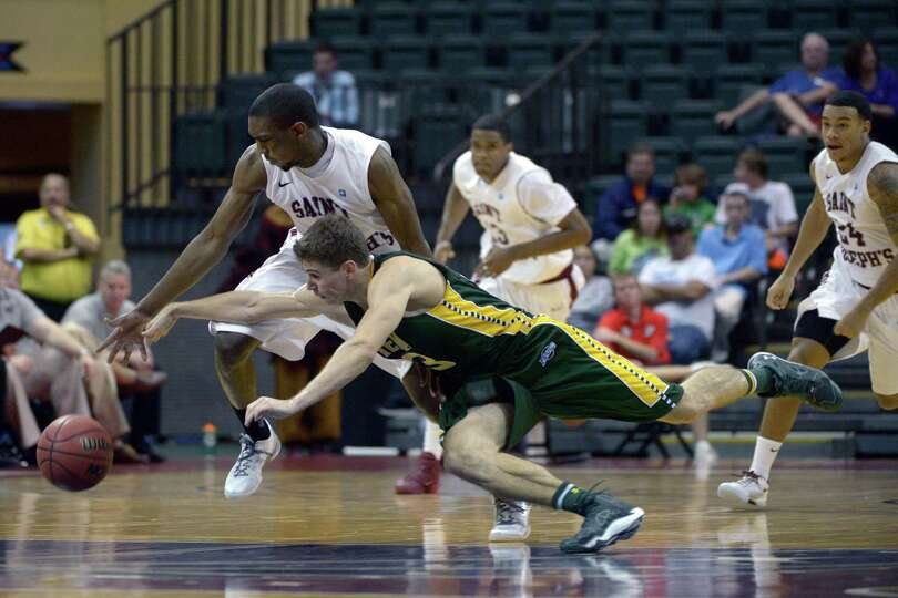 Saint Joseph's guard Langston Galloway, left, steals the ball from Siena guard Rob Poole, below, as