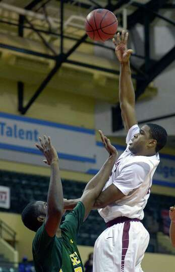 Saint Joseph's forward Ronald Roberts, right, puts up a shot in front of Siena center Imoh Silas dur