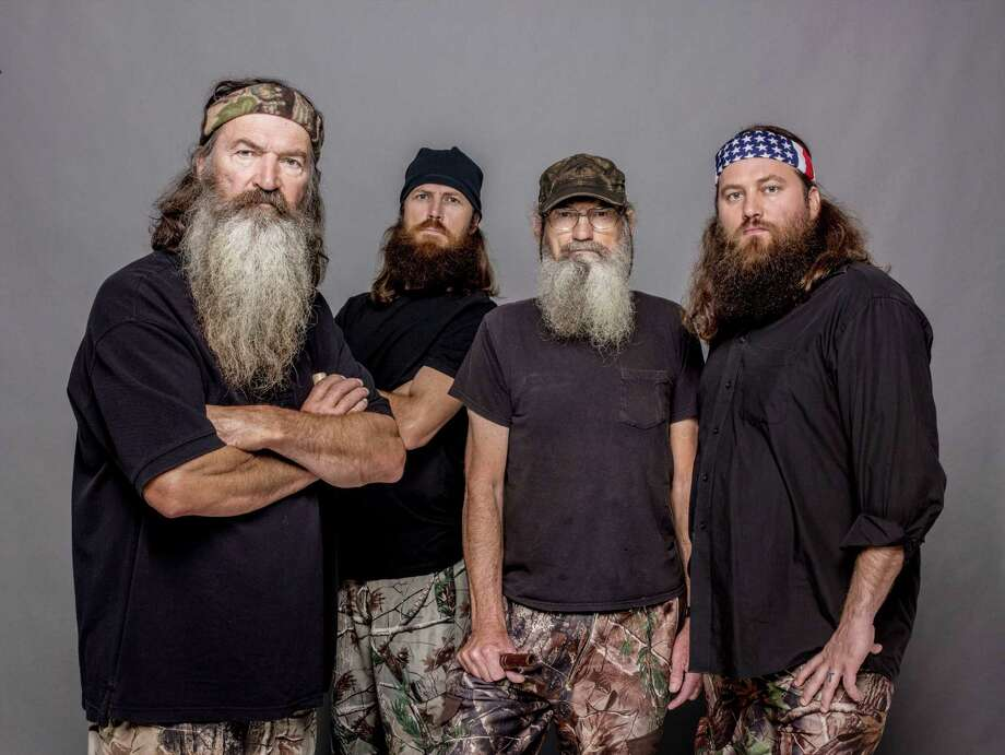 "This 2012 photo released by A&E shows, from left, Phil Robertson, Jase Robertson, Si Robertson and Willie Robertson from the A&E series, ""Duck Dynasty.""  A&E says nearly 12 million birds of a feather caught the season premiere of the hit unscripted series on Wednesday, Aug. 14, 2013.  (AP Photo/A&E, Zach Dilgard) Photo: Zach Dilgard, Associated Press / A&E"