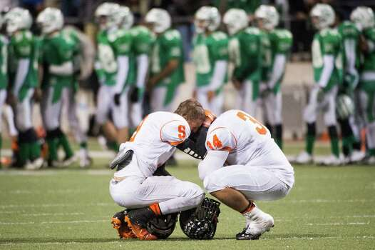 Texas City's Zack Powell (9) and Korey Robinson (34) kneel on the field after a loss to Brenham in a Class 4A Division II Regional Semifinal high school football playoff game at the Berry Center Friday, Nov. 29, 2013, in Houston. Brenham won the game 37-34. Photo: Smiley N. Pool, Houston Chronicle / © 2013  Houston Chronicle