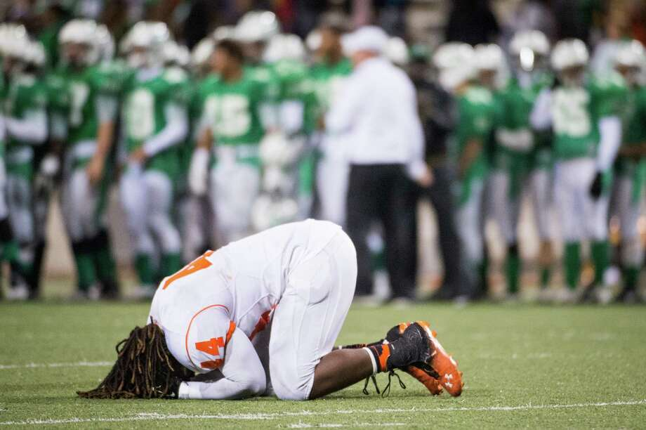 Texas City's Francois Bonilla (44) collapses on the field after a loss to Brenham in a Class 4A Division II Regional Semifinal high school football playoff game at the Berry Center Friday, Nov. 29, 2013, in Houston. Brenham won the game 37-34. Photo: Smiley N. Pool, Houston Chronicle / © 2013  Houston Chronicle