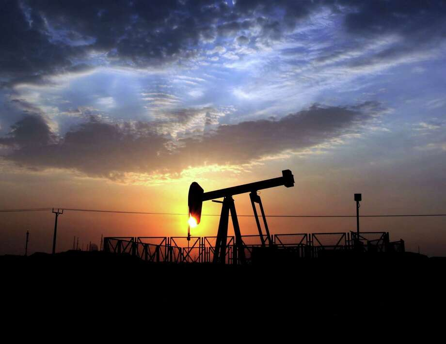 A pump jack extracts oil from the oil fields of Sakhir, Bahrain. A rule requiring U.S. companies to tell what they pay foreign nations may be on the back burner. Photo: Hasan Jamali, STR / AP
