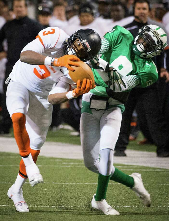 Texas City wide receiver Armanti Foreman (3) makes a catch as Brenham defensive back Deon Earls (9) defends during the first half of a Class 4A Division II Regional Semifinal high school football playoff game at the Berry Center Friday, Nov. 29, 2013, in Houston. Photo: Smiley N. Pool, Houston Chronicle / © 2013  Houston Chronicle