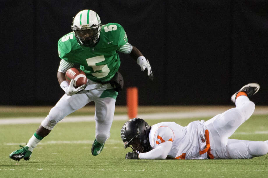 Brenham 37, Texas City 34Brenham running back  Earnest Patterson (5) gets past Texas City linebacker Cameron Moreno (11) during the first half of a Class 4A Division II Regional Semifinal high school football playoff game at the Berry Center Friday, Nov. 29, 2013, in Houston. Photo: Smiley N. Pool, Houston Chronicle / © 2013  Houston Chronicle