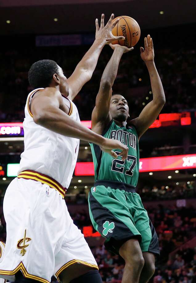 Boston Celtics' Jordan Crawford (27) shoots against Cleveland Cavaliers' Andrew Bynum in the second half of an NBA basketball game in Boston, Friday, Nov. 29, 2013. The Celtics won 103-86. (AP Photo/Michael Dwyer) ORG XMIT: MAMD110 Photo: Michael Dwyer / AP