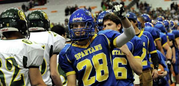 Queensbury's Kody Bruno, center, celebrates their 36-7 win over Williamsville North in the Class A state football final on Friday, Nov. 29, 2013, at the Carrier Dome in Syracuse, N.Y. (Cindy Schultz / Times Union) Photo: Cindy Schultz / 00024836A