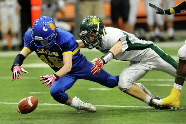 Queensbury's Timothy Voorhis, left, recovers a fumble from Williamsville North's Zachary Kelly, center, during their Class A state football final against on Friday, Nov. 29, 2013, at the Carrier Dome in Syracuse, N.Y. (Cindy Schultz / Times Union) Photo: Cindy Schultz / 00024836A