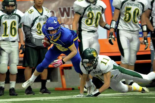 Queensbury's Timothy Voorhis, left, carries the ball as Williamsville North's Chad Steinwachs defends during their Class A state football final on Friday, Nov. 29, 2013, at the Carrier Dome in Syracuse, N.Y. (Cindy Schultz / Times Union) Photo: Cindy Schultz / 00024836A