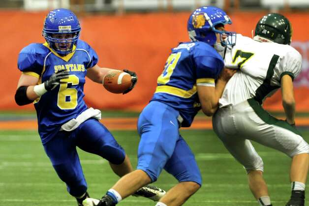 Queensbury's Philip Wettersten, left, carries the ball during their Class A state football final against Williamsville North on Friday, Nov. 29, 2013, at the Carrier Dome in Syracuse, N.Y. (Cindy Schultz / Times Union) Photo: Cindy Schultz / 00024836A
