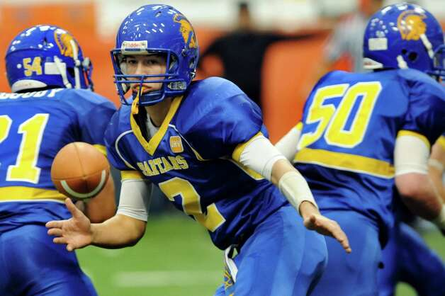 Queensbury's quarterback Aidan Switzer hands off the ball during their Class A state football final against Williamsville North on Friday, Nov. 29, 2013, at the Carrier Dome in Syracuse, N.Y. (Cindy Schultz / Times Union) Photo: Cindy Schultz / 00024836A