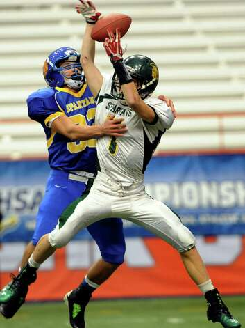 Queensbury's Brett Rodriguez, left, goes up against Williamsville Nort's Zachary Kelly who makes the catch during their Class A state football final on Friday, Nov. 29, 2013, at the Carrier Dome in Syracuse, N.Y. (Cindy Schultz / Times Union) Photo: Cindy Schultz / 00024836A