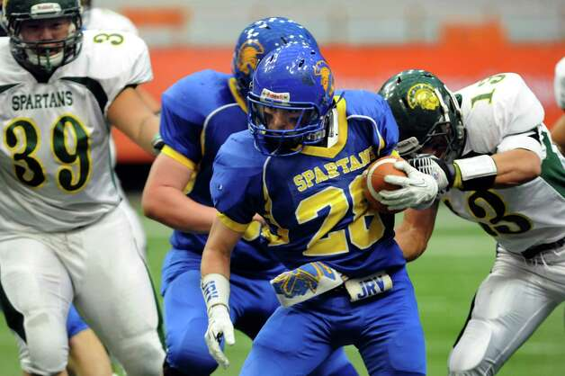 Queensbury's Kody Bruno, center, carries the ball during their Class A state football final against Williamsville North on Friday, Nov. 29, 2013, at the Carrier Dome in Syracuse, N.Y. (Cindy Schultz / Times Union) Photo: Cindy Schultz / 00024836A