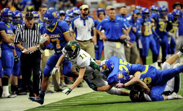 Queensbury's Kalen Minott, left, gets pushed out of bounds during their Class A state football final against Williamsville North on Friday, Nov. 29, 2013, at the Carrier Dome in Syracuse, N.Y. (Cindy Schultz / Times Union) Photo: Cindy Schultz / 00024836A