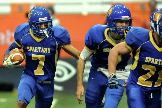 Queensbury's Kalen Minott, left, stays close to his teammates who blocked his way to gain yards during their Class A state football final against Williamsville North on Friday, Nov. 29, 2013, at the Carrier Dome in Syracuse, N.Y. (Cindy Schultz / Times Union) Photo: Cindy Schultz / 00024836A