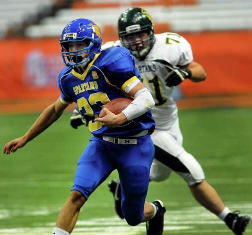Queensbury's Brett Rodriguez, left, carries the ball after making an interception as Williamsville North's Ryan Judson defends during their Class A state football final on Friday, Nov. 29, 2013, at the Carrier Dome in Syracuse, N.Y. (Cindy Schultz / Times Union) Photo: Cindy Schultz / 00024836A