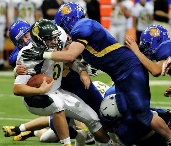 Queensbury's defense sacks Williamsville North's quarterback Ryan Majewski during their Class A state football final on Friday, Nov. 29, 2013, at the Carrier Dome in Syracuse, N.Y. (Cindy Schultz / Times Union) Photo: Cindy Schultz / 00024836A