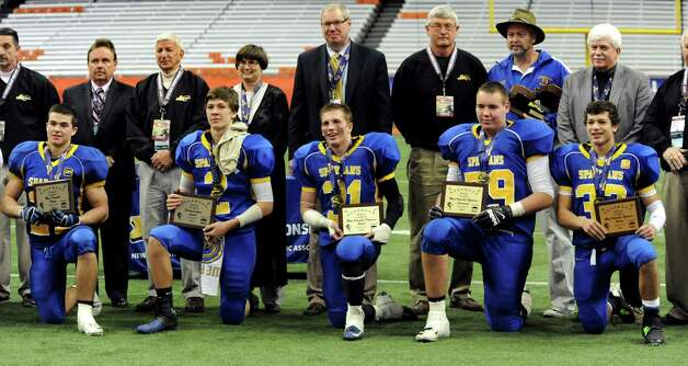 Queensbury's outstanding players of the game pose with their awards following their Class A state football final against Williamsville North on Friday, Nov. 29, 2013, at the Carrier Dome in Syracuse, N.Y. (Cindy Schultz / Times Union) Photo: Cindy Schultz / 00024836A