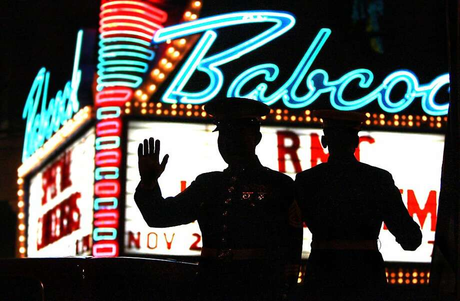 Members of the U.S. Marine Corps wave to a crowd while riding a float past the Babcock Theatre during the annual Holiday Parade in Billings, Mont. on Friday Nov.  29, 2013. (AP Photo/Billings Gazette, Paul Ruhter) Photo: PAUL RUHTER/Gazette Staff, Associated Press