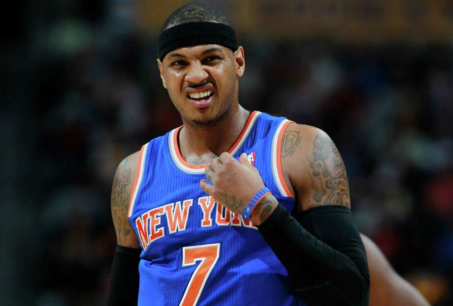 New York Knicks forward Carmelo Anthony reacts after being fouled while shooting against th Denver Nuggets in the first quarter of an NBA basketball game in Denver, Friday, Nov. 29, 2013. (AP Photo/David Zalubowski)  ORG XMIT: CODZ107 Photo: David Zalubowski / AP