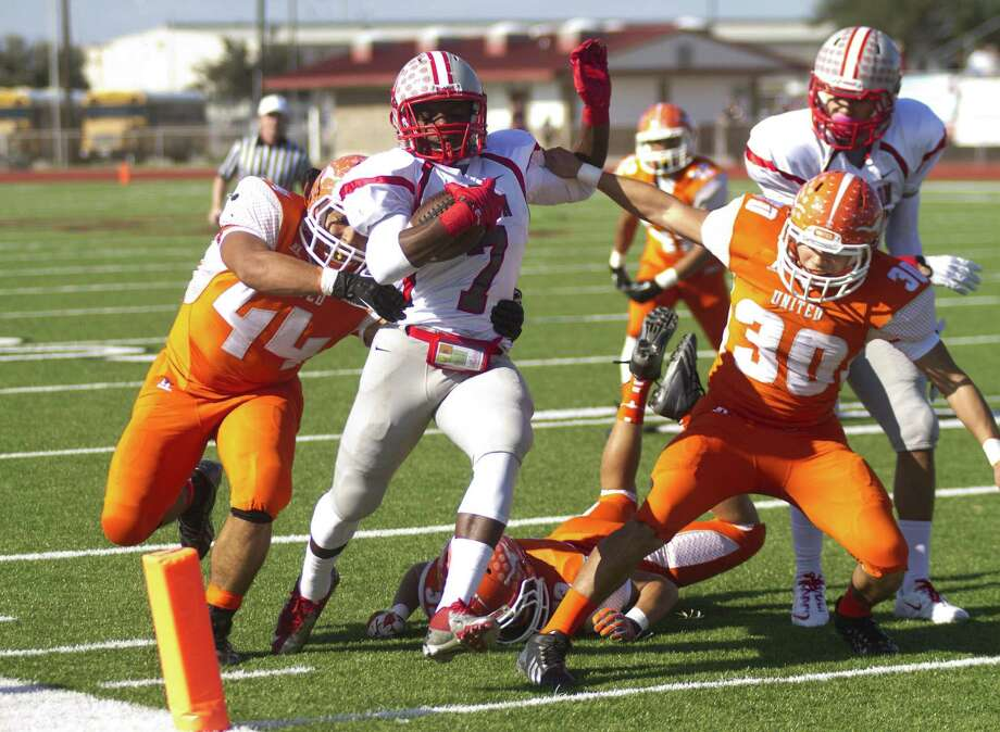 Judson's Jo'Von Kyle scores on an 11-yard run in the first quarter at Cabaniss Field in Corpus Christi. Kyle ran for three touchdowns in the Rockets' win. Photo: Jason Mack / Laredo Morning Times