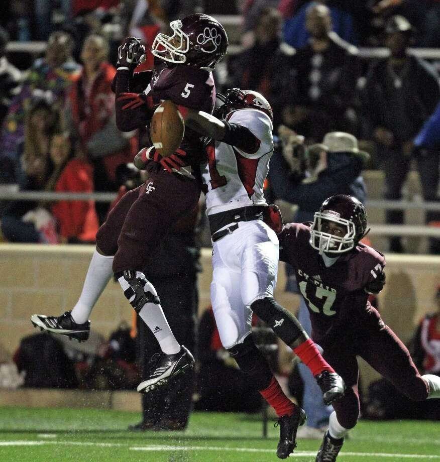 Cy Fair 9, North Shore 7Cy-Fair's David Dudley (5) breaks up a pass intended for North Shore's Eric Monroe during the first half of a high school football playoff game, Friday, November 29, 2013, at Tully Stadium in Houston. Photo: Eric Christian Smith, For The Chronicle