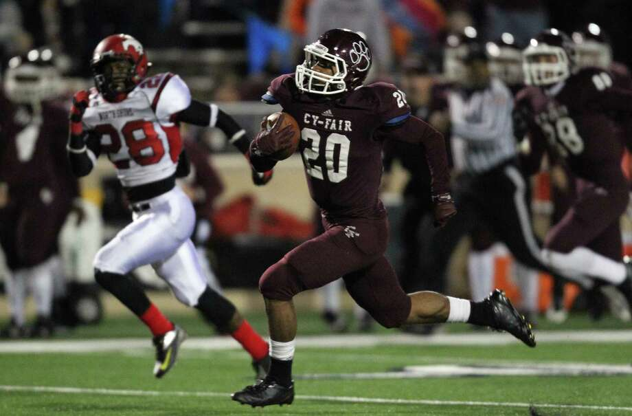 Cy-Fair's Dillon Birden (20) rushes past North Shore's Darius Mouton (28) for a 75-yard gain during the second half of a high school football playoff game, Friday, November 29, 2013, at Tully Stadium in Houston. Photo: Eric Christian Smith, For The Chronicle