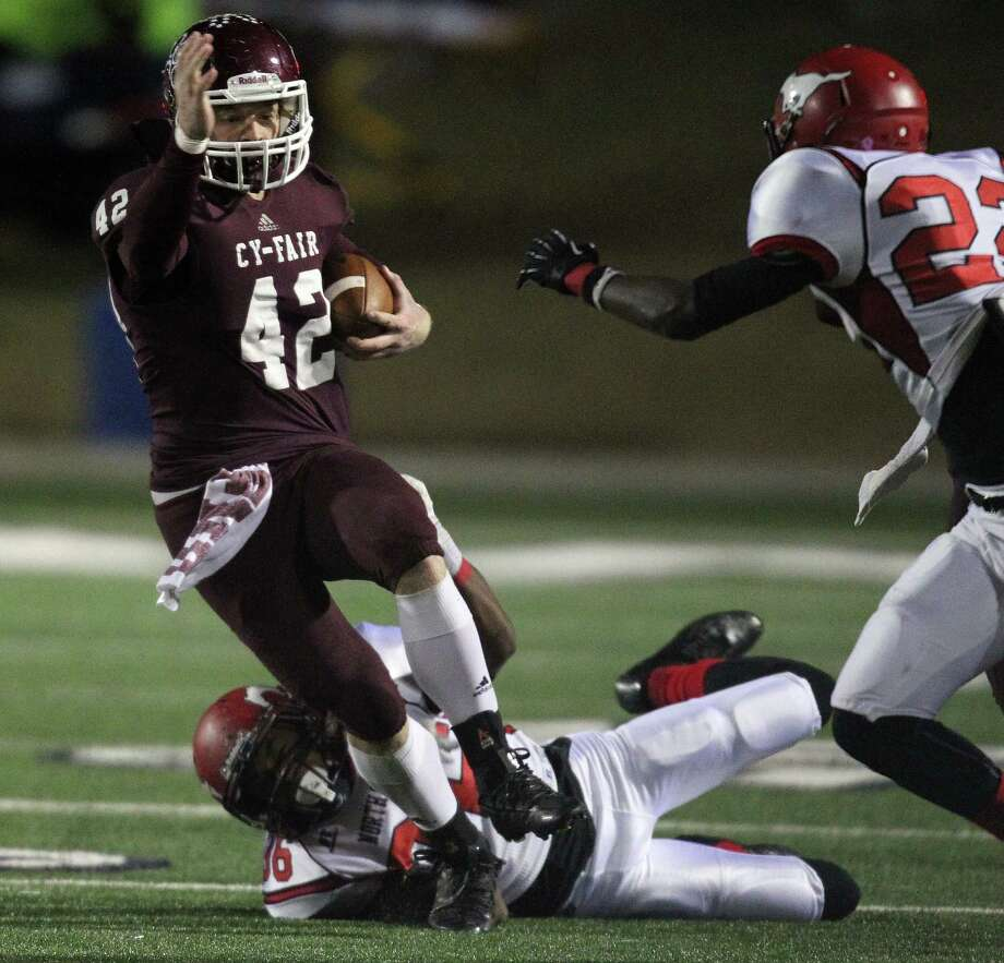 Cy-Fair's Drew Tobler (42) is tackled by North Shore's J.T. Matthews during the first half of a high school football playoff game, Friday, November 29, 2013, at Tully Stadium in Houston. Photo: Eric Christian Smith, For The Chronicle
