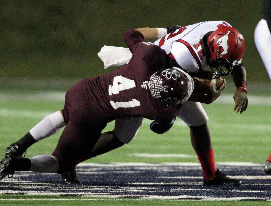 Cy-Fair's James Kohlschmidt, left, sacks North Shore quarterback Lawance McCardell during the first half of a high school football playoff game, Friday, November 29, 2013, at Tully Stadium in Houston. Photo: Eric Christian Smith, For The Chronicle