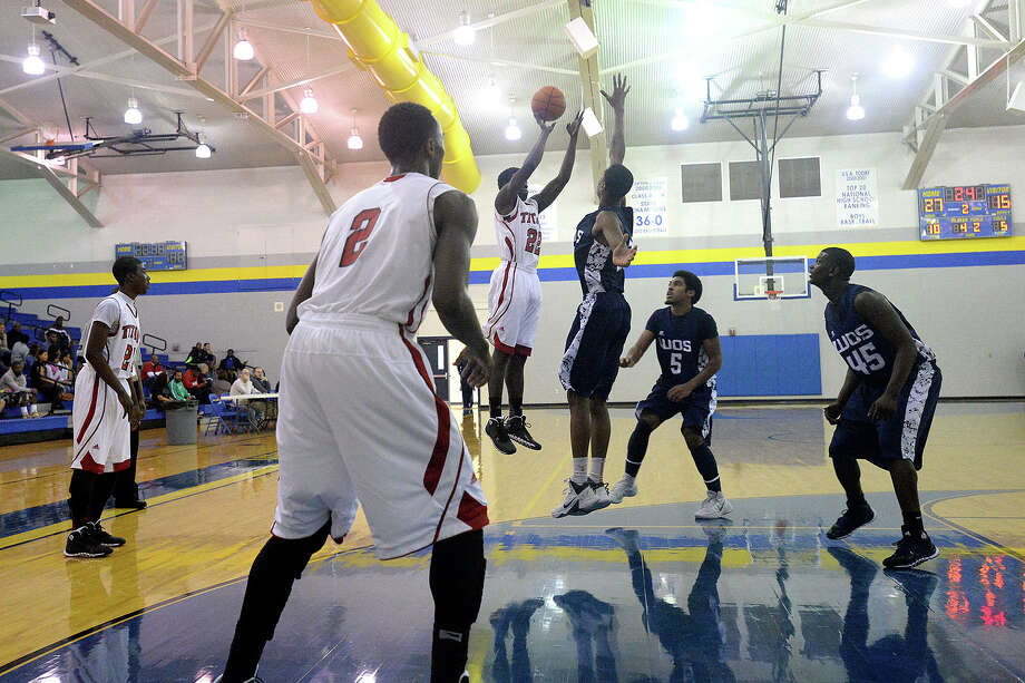 Port Arthur Memorial Titans Darren Williams shoots and scores a three point shot during the first quarter against West Orange-Stark at Ozen, Friday. Michael Rivera/@michaelrivera88