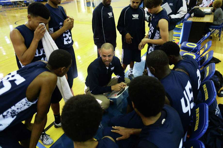 West Orange-Stark head coach Jason Wilkins talks to the Mustangs during a time out against Port Arthur Memorial boys basketball team at Ozen, Friday. The final score was 64-45, with Port Arthur for the win. Michael Rivera/@michaelrivera88