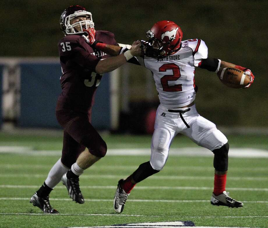 North Shore's Kevian DeLong (2) stiff-arms Cy-Fair's Jereel Cooper during the second half of a high school football playoff game, Friday, November 29, 2013, at Tully Stadium in Houston. Photo: Eric Christian Smith, For The Chronicle