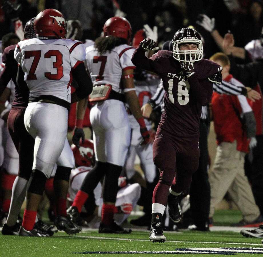 With a 9-7 lead and forty-seven seconds left in the game, Cy-Fair's Maxx Chrest (18) celebrates the Bobcats' stop of North Shore on fourth-and-ten during a high school football playoff game, Friday, November 29, 2013, at Tully Stadium in Houston. Photo: Eric Christian Smith, For The Chronicle