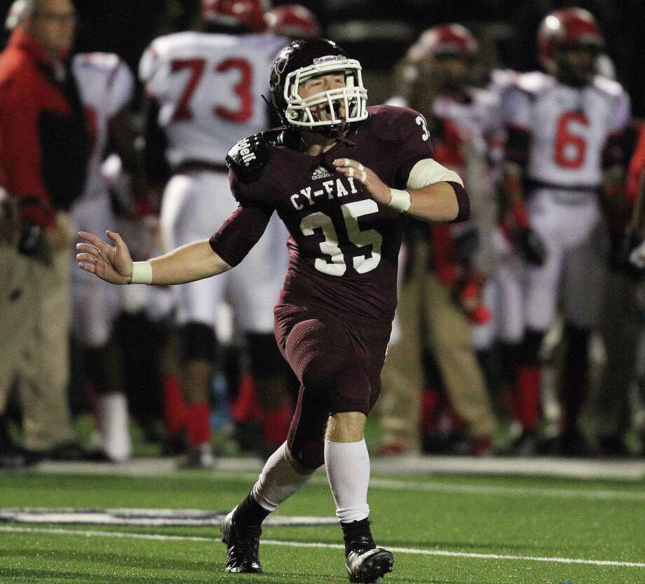 With a 9-7 lead and forty-seven seconds left in the game, Cy-Fair's Austin Scheaffer (35) celebrates the Bobcats' stop of North Shore on fourth-and-ten during a high school football playoff game, Friday, November 29, 2013, at Tully Stadium in Houston. Photo: Eric Christian Smith, For The Chronicle