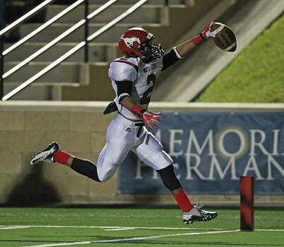 North Shore's Kevian DeLong scores a 15-yard touchdown during the second half of a high school football playoff game against Cy-Fair, Friday, November 29, 2013, at Tully Stadium in Houston. Photo: Eric Christian Smith, For The Chronicle