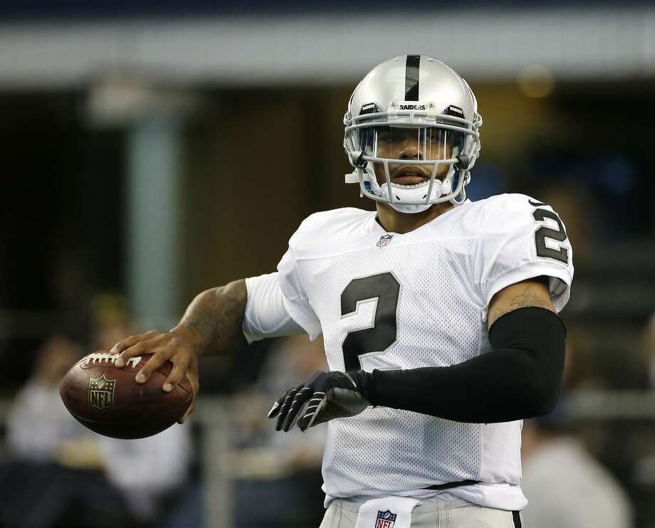 Oakland Raiders quarterback Terrelle Pryor warms up before an NFL football game against the Dallas Cowboys Thursday, Nov. 28, 2013, in Arlington, Texas.  (AP Photo/Tim Sharp) Photo: Tim Sharp, Associated Press