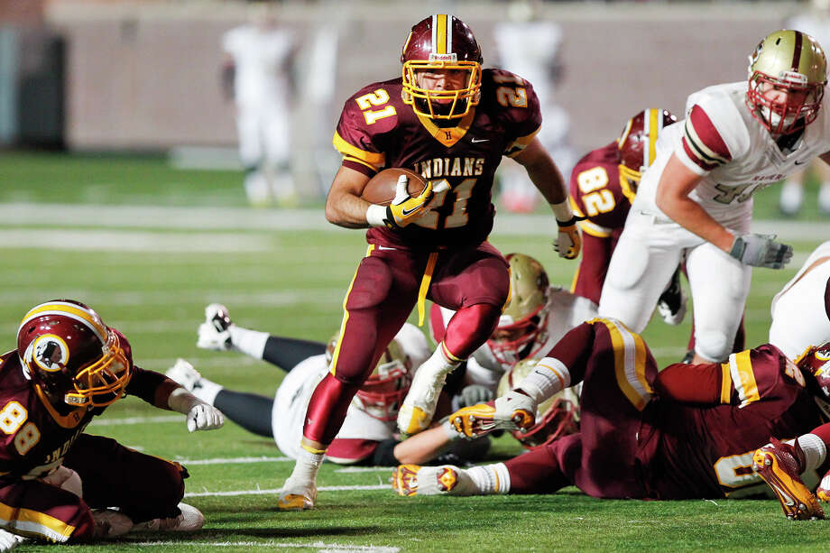 Harlandale's Nicholas Martinez (center) breaks through the line of scrimmage during the third quarter of their Class 4A Division I third round playoff game with Leander Rouse at Bobcat Stadium in San Marcos on Friday, Nov. 29, 2013.  Rouse beat the Indians 43-21. Photo: MARVIN PFEIFFER, Marvin Pfeiffer/ Express-News / Express-News 2013