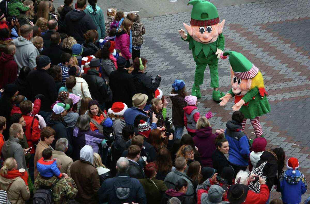 Spectators watch the action during the annual Macy's Holiday Parade. Photographed on Friday, Nov. 29, 2013 in downtown Seattle.