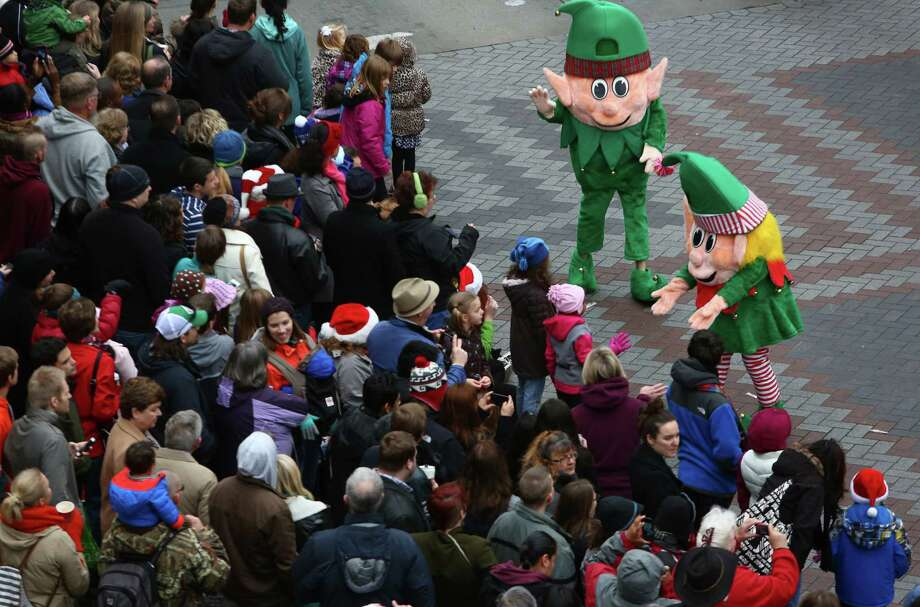Spectators watch the action during the annual Macy's Holiday Parade. Photographed on Friday, Nov. 29, 2013 in downtown Seattle. Photo: JOSHUA TRUJILLO, SEATTLEPI.COM / SEATTLEPI.COM