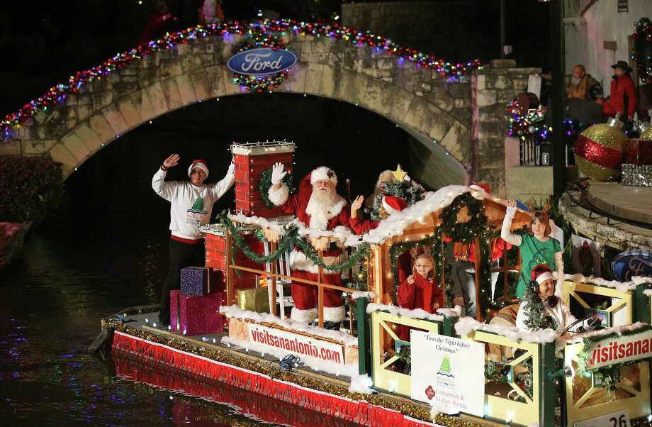 "A familiar seasonal figure hitches a ride on the Convention & Visitors Bureau's ""Twas The Night Before Christmas"" float as it passes through the Arneson River Theatre. Photo: Photos By Edward A. Ornelas / San Antonio Express-News"