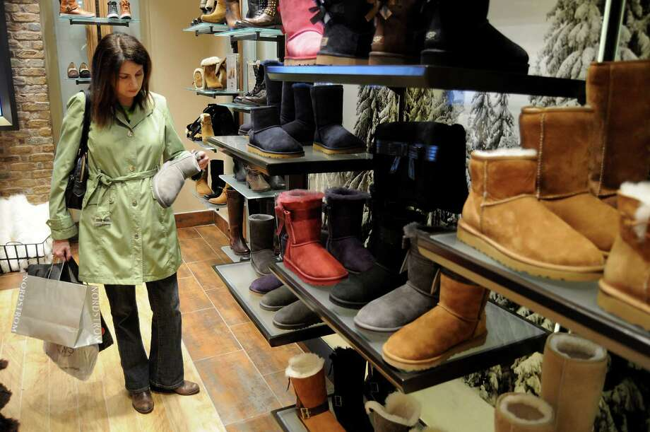 Elise Neal shops for boots at the Ugg store at the Galleria. The store selling the distinctive boots opened over the summer. Photo: Dave Rossman, Freelance / © 2013 Dave Rossman