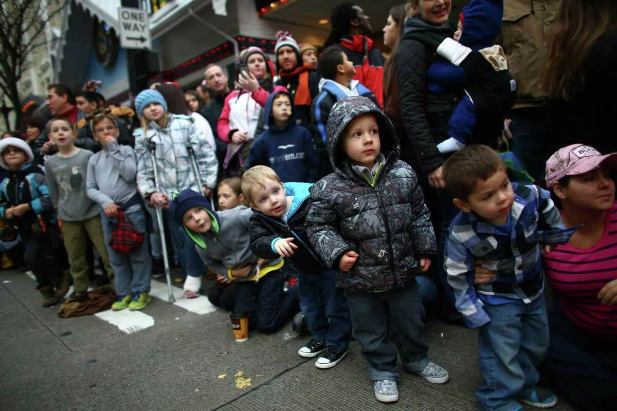 Spectators watch during the annual Macy's Holiday Parade. Photographed on Friday, Nov. 29, 2013 in downtown Seattle.