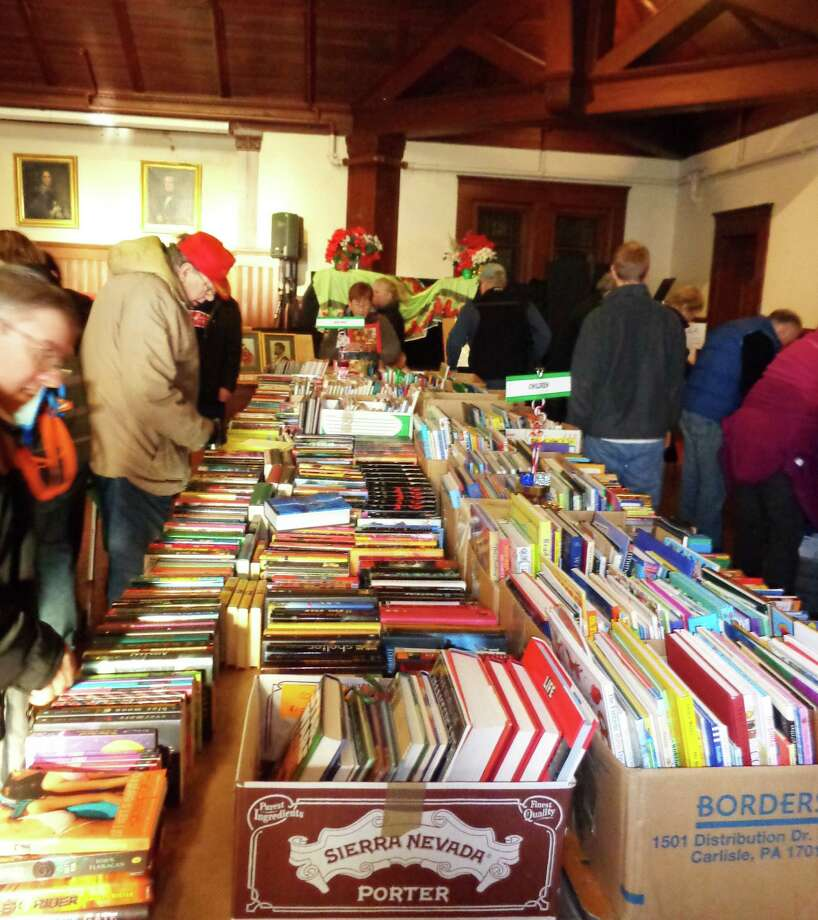 Dozens of book lovers browsed through hundreds of texts on off Friday at the Pequot Library's Black Friday/Saturday Book Sale. Photo: Meg Barone / Westport News contributed