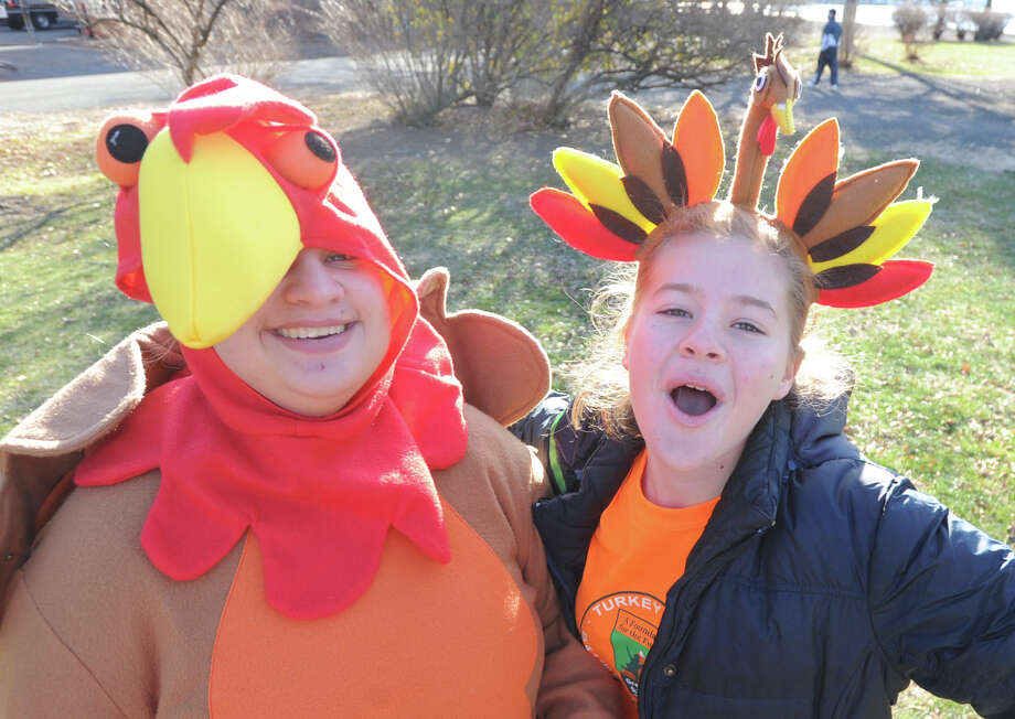 Luna Kodde, 18, left, and Liz Fernandez, 15, both of Greenwich, dressed for the occassion during the Greenwich Alliance for Education's 3rd annual Turkey Trot at Roger Sherman Baldwin Park in Greenwich, Saturday morning, Nov. 30, 2013. Photo: Bob Luckey / Greenwich Time
