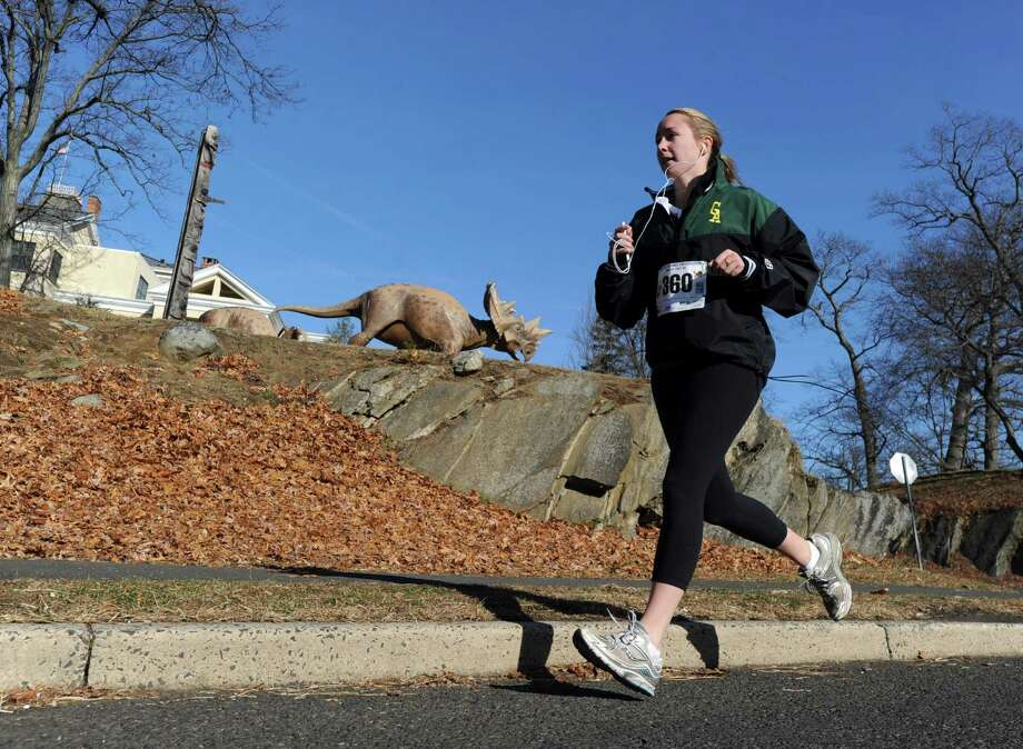 A runner passes by the Bruce Museum during the Greenwich Alliance for Education's 3rd annual Turkey Trot that finished at Roger Sherman Baldwin Park in Greenwich, Saturday morning, Nov. 30, 2013. Photo: Bob Luckey / Greenwich Time